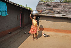 Tribal People in India. July 02, 2011.Bastar, Chhattisgarh,Madhya Pradesh,India,Asia-A tribal woman going for water collection in the remote village of Bastar stock photography