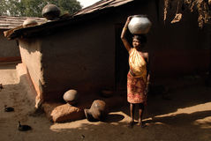 Tribal People in India. July 02, 2011.Bastar, Chhattisgarh,Madhya Pradesh,India,Asia-A tribal woman going for water collection in the remote village of Bastar stock image