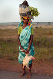 Tribal People in India. July 02, 2011.Bastar, Chhattisgarh,Madhya Pradesh,India,Asia-Tribal woman return from the weekly market in the remote village of Bastar royalty free stock photo