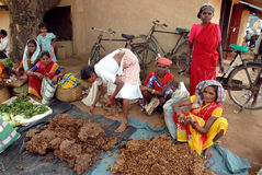 Tribal People in India. October 10, 2011.Bastar, Chhattisgarh,Madhya Pradesh,India,Asia-Tribal women selling their home made product at the weekly market in a royalty free stock image