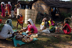 Tribal People in India. October 10, 2011.Bastar, Chhattisgarh,Madhya Pradesh,India,Asia-Tribal women selling their product at the weekly market in a remote area stock image