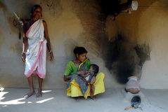 Tribal People in India. October 28,2011 Dukru,Purulia,West Bengal,India,Asia-A tribal family in their house at the remote village of Purulia West Bengal royalty free stock image