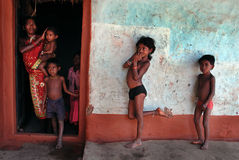 Tribal People in India. June 02, 2012.Bastar, Chhattisgarh,Madhya Pradesh,India,Asia-A tribal family at their traditional mud house in the remote village of stock image