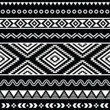 Tribal seamless aztec white pattern on black background Royalty Free Stock Image
