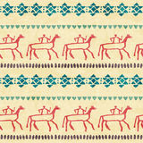 Tribal seamless pattern with stylized riders and archaic geometric ornament Royalty Free Stock Photography