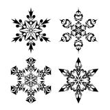 Tribal Snow Flakes. 4 tribal snow flakes isolated on white Royalty Free Stock Photography