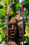Tribal statues. African traditional wooden statue against tree Stock Photo