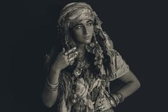 Gypsy style young woman wearing tribal jewellery portrait Stock Photography