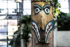 Tribal symbolic wooden sculpture. With bokeh Stock Image