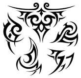 Tribal tattoo set on white. Tribal tattoo and aboriginal motif set Stock Photos
