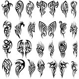 24 Tribal Tattoos. Set of 24 Tribal Tattoos in Black Color Royalty Free Stock Image