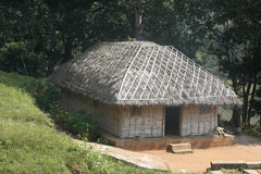 Tribal Thatch Hut inside Deep Jungle Stock Photography