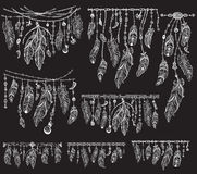 Tribal theme with feathers on black Royalty Free Stock Photography