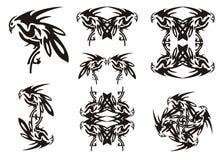 Tribal twirled bird set Stock Images