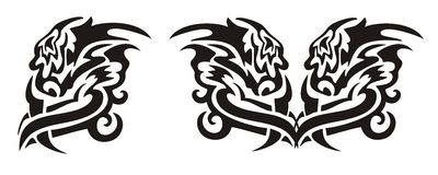 Tribal twirled dragon head and heart of a dragon Royalty Free Stock Photography