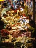 Tribal villagers bargain for vegetables Stock Images