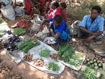 Tribal villagers bargain for vegetables Royalty Free Stock Image