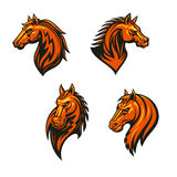 Tribal wild horse or mustang head icon set. Tribal horse head with flaming mane icon set. Wild horse and mustang with tribal fire flame ornament. Sporting mascot Royalty Free Stock Photography