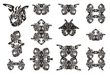 Tribal winged dragon symbols. Black on the white Stock Images