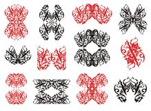 Tribal wolf symbols and wolf frames. Red and black on the white Royalty Free Stock Photo