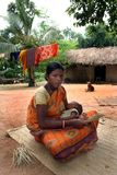 Tribal woman. A tribal woman is sitting with her child in front of her house Stock Photos