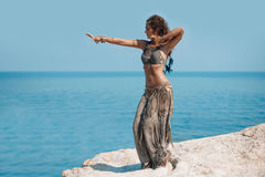 Tribal woman belly dancer outdoors. Belly dance tribal fusion young woman with silver and gold ethnical accessories Royalty Free Stock Image