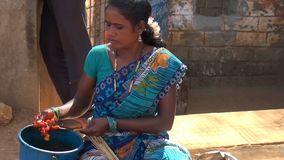 Tribal Woman Cooking Chicken Kabab stock footage
