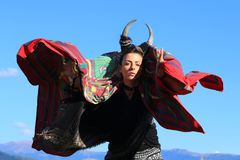 Tribal woman with horns Dancing on the mountain stock photos