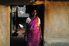 Tribal Woman in India. October 28,2011 Kashipur,Purulia,West Bengal,India,Asia-A tribal woman in her house during sunset at the remote village of Purulia West royalty free stock image