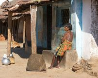 Tribal woman near home Stock Photo