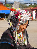 Tribal woman in the north of Thailand. Thailand, Chieng Rai 8/12/2016 Tribal woman sitting beside a street waiting to sale handicraft product to a tourists who Royalty Free Stock Photography