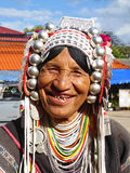 Tribal woman in the north of Thailand. Thailand, Chieng Rai 8/12/2016 A tribal woman standing beside a street and smile to a tourists who went to visit a Tribal Royalty Free Stock Image