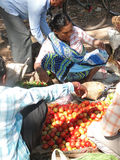 A Tribal woman sells fresh vegetables Royalty Free Stock Photos