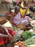 Tribal woman sells vegetables Stock Image