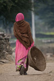 Tribal woman walking Royalty Free Stock Photography