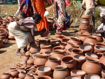 Tribal women buy clay pots Royalty Free Stock Images