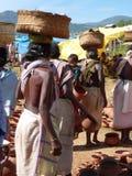 Tribal women buy clay pots Stock Photo