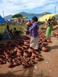 Tribal women buy clay pots Stock Images