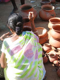 Tribal women buy clay pots Stock Photos