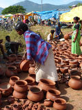 Tribal women buy clay pots Royalty Free Stock Photos