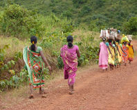Tribal women carry goods Stock Photography