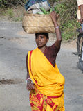 Tribal women carry goods Stock Image