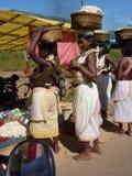 Tribal women carry goods  on their head Stock Photos