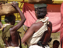 Tribal women carry goods  on their heads Royalty Free Stock Photography