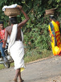 Tribal women carry goods  on their heads Royalty Free Stock Photos