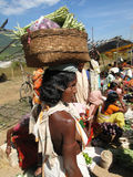 Tribal women carry goods  on their heads Stock Photo