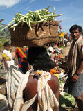 Tribal women carry goods  on their heads Stock Photos