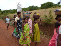 Tribal women carry goods  on their heads Royalty Free Stock Images