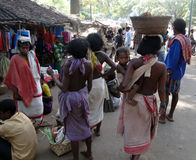 Tribal women carry goods  on their heads Stock Images