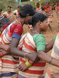 Tribal women link arms for Gdaba harvest dance Royalty Free Stock Image